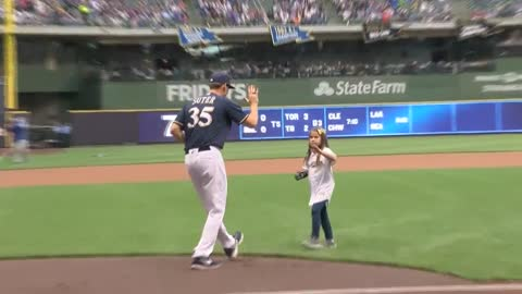 8-year-old Hailey Dawson throws out first pitch at Monday's Brewers game with help of 3D-printed hand