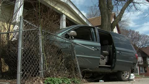 Van plows into Milwaukee resident's front yard in south side