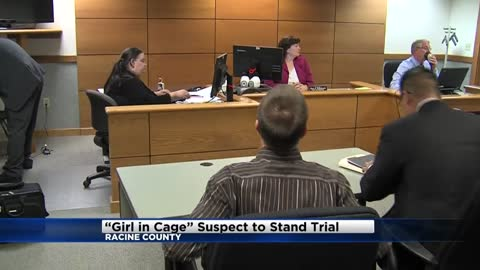 Man accused of locking 9-year-old in dog cage ordered to stand trial