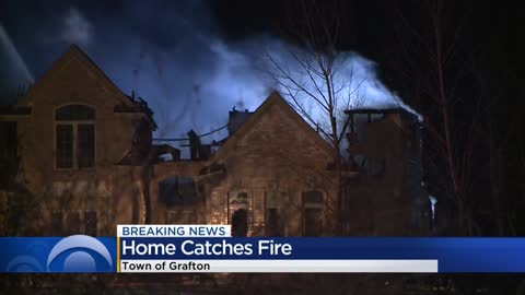 ' Crews battle massive house fire in town of Grafton