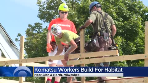 Volunteers help build Habitat for Humanity homes for families...
