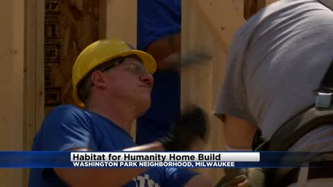 Future Habitat homeowner joins celebration of walls being raised on future home