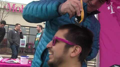 Volunteers shave heads to support kids battling cancer
