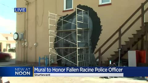 """To know John was to love him:"" Bar and grill honoring fallen Racine Police Officer with mural"
