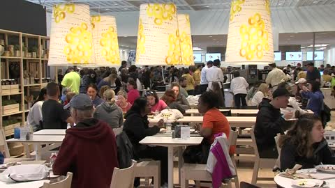 Customers line up outside Oak Creek IKEA store on opening day