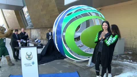 Bucks and Johnson Controls unveil open globe sculpture outside...
