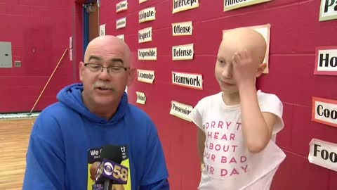 Elementary students in New Berlin shave their heads in support of fellow classmate
