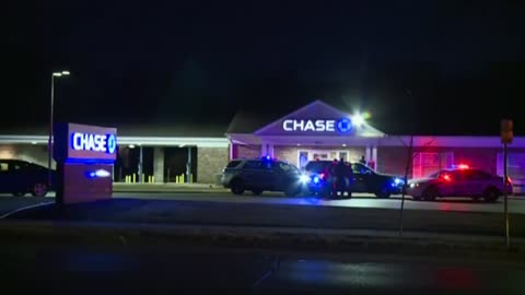 Chief: Armed security guard shoots, kills robber at Madison bank