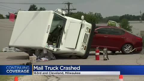 Two taken to hospital after crash involving mail truck in