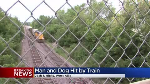 Man, dog expected to be okay after being hit by train in West Allis