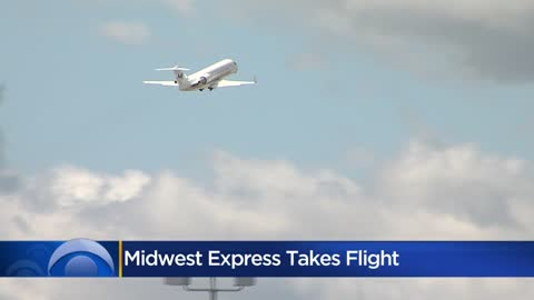 Midwest Express marks return announcing airline routes, showcasing plane