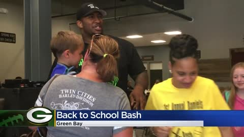 Packer Mike Daniels and wife host Back to School Bash, give school...