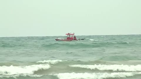UPDATE: Search efforts resume for missing swimmer, one swimmer dies from injuries