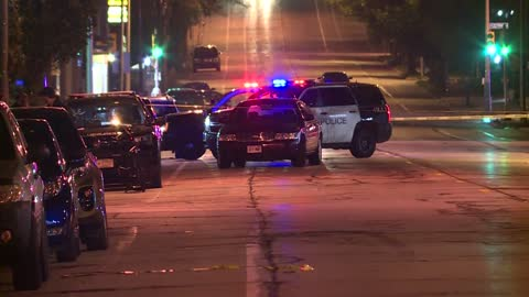 Woman killed in crossfire while driving near 5th and Center