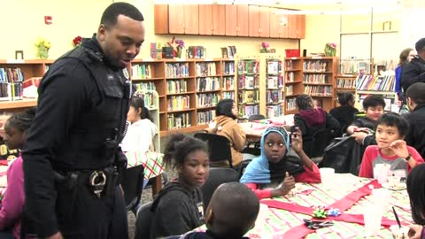 Milwaukee police officers donate toys for surprise holiday party