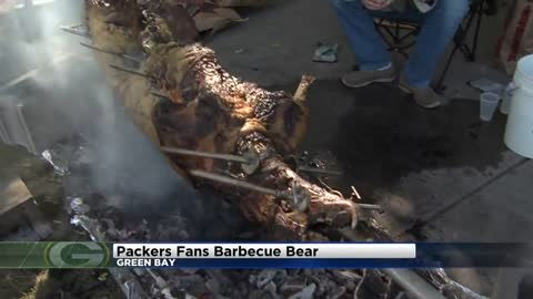 Packer fans barbecue a 200 pound bear at Lambeau Field