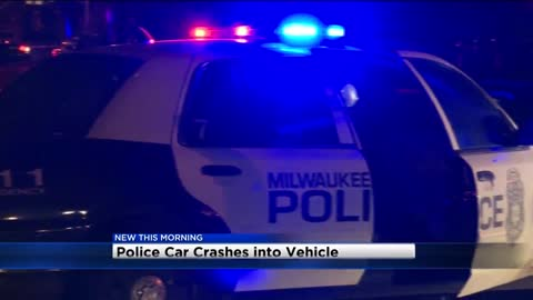 Two officers hurt after MPD squad collides with car