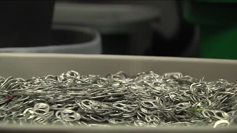 Portage girl collecting pop tabs for another World Record attempt