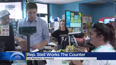 Rep. Steil helps customers at Kenosha gas station