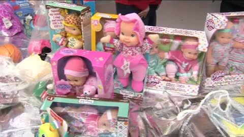 Parents pick out donated toys for Christmas