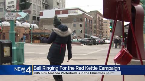 Bell ringers support Salvation Army's Red Kettle Campaign at...
