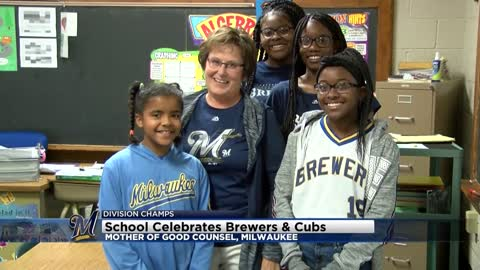 Local elementary school students swap out uniforms for Cubs and Brewers gear