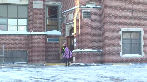 Flu-stricken school reopens Monday