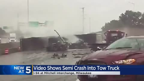 Video shows semi crash into tow truck at Mitchell Interchange