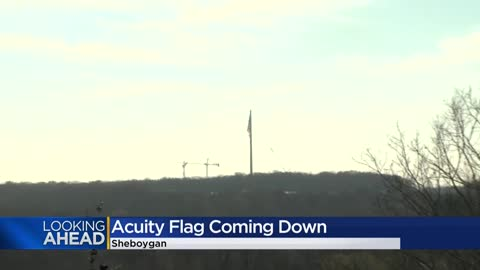 Giant Acuity Insurance flag in Sheboygan coming down for maintenance