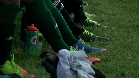 Case High School varsity soccer team sporting lime green shoelaces in support of teammate's dad battling cancer
