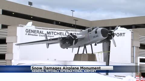 Snow damages airplane monument at Mitchell International Airport
