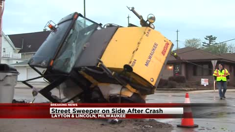 UPDATE: Two hurt after car hits Milwaukee DPW street sweeper