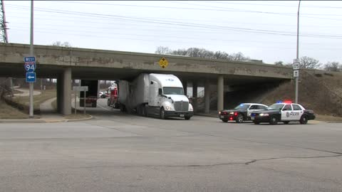 Semi-truck stuck under bridge near General Mitchell Blvd. and...