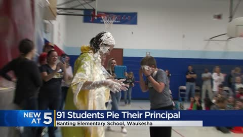 Waukesha principal takes pie to the face for a good cause