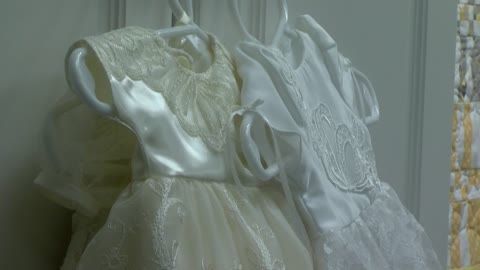 Volunteer group creates Angel Gowns for families dealing with...