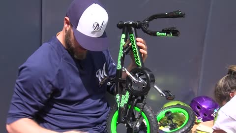 Brewers players and coaches help build bicycles for Milwaukee children