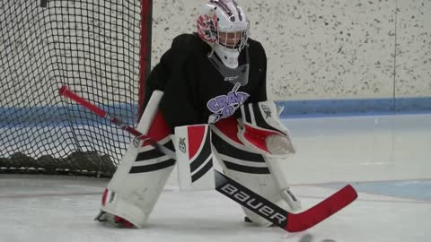 Two prosthetic legs stop pucks, not dreams for young WI goalie