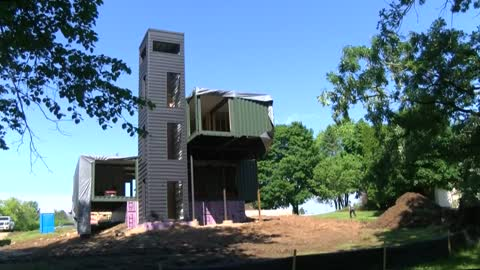 Construction of shipping container home provides spectacle in Grafton