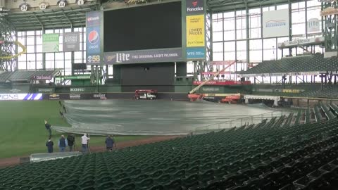 Miller Park Grounds Crew takes tarp off field