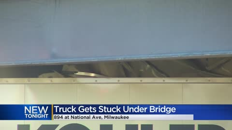 Truck gets stuck under 894 bridge at National Avenue