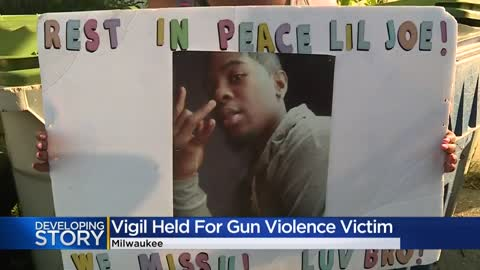 Family and friends hold vigil for man shot in alley last month